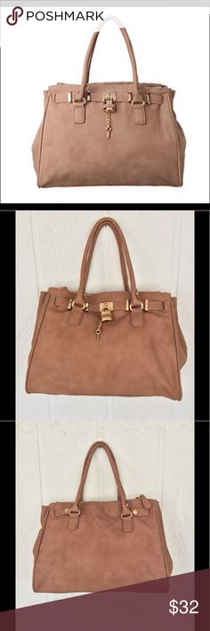 """ALDO SATCHEL HANDBAG Gorgeous camel brown Aldo purse with tons of storage. Two full top zippered compartments.  Interior has one small zippered pocket and 2 slip pockets. Magnetic kiss closure. Gleaming gold hardware lock and key hang from front of bag. Two small spots where finish came off. I magnified and included pictures but they are barely noticeable when looking at bag. Bags is 13"""" wide and 11"""" tall. Double rolled faux leather handles. Interior is like brand new. NO STAINS ! Aldo Bags…"""