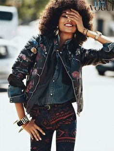Flower embroidered leather jacket & tribal print jeans & denim shirt & chunky braceletes (all in darkish tones)