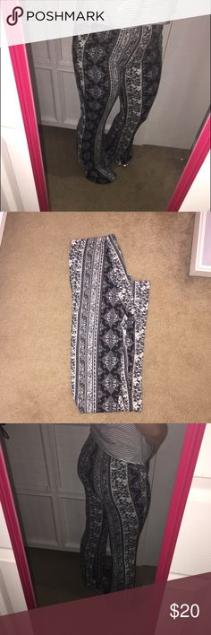 Soft flair yoga pants PRICE IS FIRM. These I have never worn because as you can see they are to long, I am 5ft by the way. These are very soft in a grayish white color. They are skin tight until the bottom on the pants, and they are very stretchy! Charlotte Russe Pants