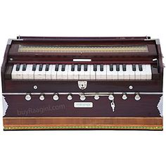 MAHARAJA Harmonium No. 5200n - 9 Stop - Sangeeta - 3½ Octave - With Coupler, Tuned to A440 - Mahogany Color (PDI-DC) buyRaagini.com http://www.amazon.co.uk/dp/B00776O4HK/ref=cm_sw_r_pi_dp_WGwgvb1KQW56W
