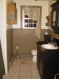 """Beadboard Idea for Laundry Room/Bath.....see what Adam thinks! Great """"cheat"""" for easy way to get behind the water tank and washer/dryer! Paint the beadboard cream, paint walls the dark green so to flip the colors pictured here."""