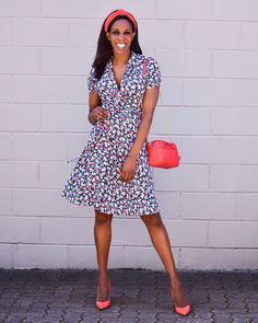 Printed swing dress worn with orange accessories and pumps | For more style inspiration visit 40plusstyle.com