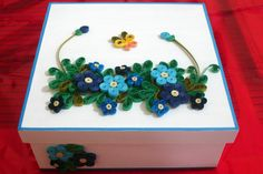 Wooden box with quilling design.