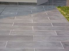 Rectangular bluestone set in concrete. One size set in a running bond pattern, more modern than random rectangular pattern.