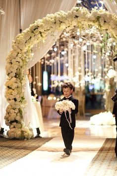 Have your ring bearer carry a soft floral pillow as light as snow down the aisle.Photo Credit:Mel Barlow/Created By:Tantawan Bloom