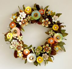 flowers = felt + paper + buttons on wire wreath with floral wire, plus plastic (store-bought) leaves in green and rust Paper Flower Wreaths, Flower Crafts, Paper Flowers, Floral Wreath, Felt Flowers, Diy Flowers, Paper Art, Paper Crafts, Wire Wreath Frame