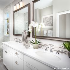 Sizable countertops and dual sinks allow plenty of room for morning routines, while contemporary accent tiles add texture and visual interest to this clean aesthetic. | Pulte Homes