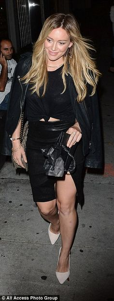 Attention to detail:She polished off the edgy look with a leather jacket and classy white heels, while toting her belongings in a designer handbag