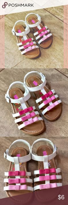 nickelodeon dora sandals • skid resistant • white with pink bow accents • around the ankle velcro closure • excellent condition: small knick on dark pink bow on right sandal Nickelodeon Shoes Sandals & Flip Flops
