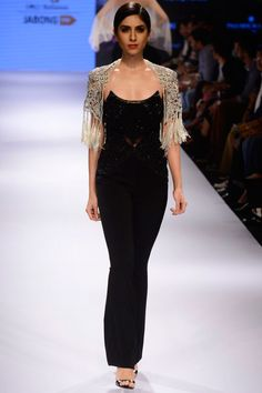 Black embroidered jumpsuit with tassel bolero jacket available only at Pernia's Pop Up Shop.