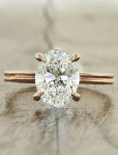 Engagement rings with oval diamond by Ken & Dana Design. Officially the most unique wedding rings I've ever seen! by FutureEdge