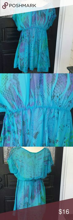 Sheer aqua blue , purple and green shirt Sheer flowy aqua blue , purple and green printed hip length shirt.  Seems to run small.  Tag says medium.  Waist is gathered and stretchy with a tie back. Tops Blouses