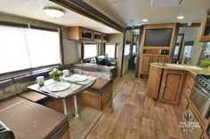 The Wildwood 28DBUD is an ideal camper for a family featuring an open floor plan with super slide. There is ample sleeping room in two double bunks and a dinette and sofa comfortably sleeping up to eight adults. The camper size and value makes this unit one of our number one bunk house travel trailers! {WW147}