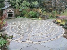 Bluestone and Cobble Stone Make a One Of A Kind Outdoor Patio