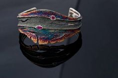 Cuff | Elisenda De Haro. 'Reef'.  Oxidized silver and rubies.