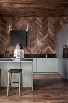 Deep colors combined with various wood textures, cement and ceramic granite tiles give a unique personality to this partment is situated in the center of Saint-Petersburg and refurbished by INT2architecture. #wood #kitchen