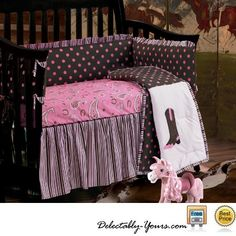 Pink Paisley bedding for the littlest of Cowgirls! The four patch comforter features pink polka dots on a brown ground with opposite patches of cowgirl boots and strip oversize piping detail.   A square pillow with rows upon rows of white eyelet ruffles and a square patch pillow matching the comforter with a cowboy boot are available separately to add to the western theme throughout her room.   #Western #Crib #Nursery #Bedding #Baby #Girl #DelectablyYours