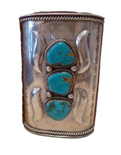 """TURQUOISE BOWGUARD KETOH CUFF    This Vintage Native American bracelet would have been used as a wrist guard to shield their wrists from the snap of the bow string. 4""""L; 4""""W; 8.5"""" wrist opening. Tie closure  $1,325.00$332.00  (Savings: $993.00)"""
