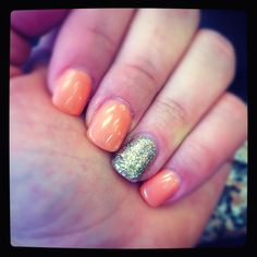 Coral nails with a bit of glitter <3