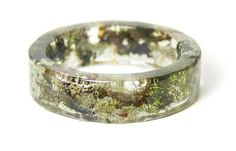Forest Mix BraceletThis Forest Mix slip on style bangle is made from ModermFlowerChild. Real Moss, Lichen, Sticks, Dirt and other organic earthy foliage are embedded into water clear resin and shaped into this one of kind piece.