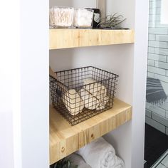 Make your own modern Built-In Shelving with this simple DIY tutorial. Love the natural wood used in this beautiful bathroom renovation!