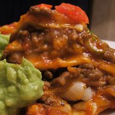 """Mexican Lasagna - """"This dish is a family favorite. It is best served with salsa and sour cream. It is also wonderful reheated in the microwave as leftovers."""""""