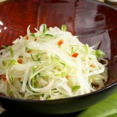 Green Papaya Salad. This Thai-inspired salad makes use of the papayas that grow throughout Hawaii. This version is tossed with tender, sweet pea shoots. Make an extra batch of the vinaigrette to keep on hand in the refrigerator—use it as a marinade for vegetables, a flavorful dressing for fresh melon or as a sauce to splash over grilled fish or chicken.