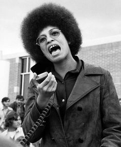 Communist, feminist and Black Panther supporter Angela Davis set the benchmark for the globular style in the early with her perfectly circular cloud of loose curls. Angela Davis, Black Panthers Movement, Black Panther Party, Power To The People, Black Power, Black History Month, Black Is Beautiful, Beautiful Women, Black People