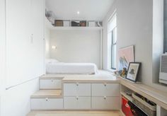16 gorgeous studio apartments replete with functional features - This enviable platform bed provides plenty of built-in storage. Tiny Bedroom Design, Girl Bedroom Designs, Home Room Design, Room Ideas Bedroom, Small Room Bedroom, Bedroom Layouts, Home Bedroom, Bedroom Decor, Bedroom Ideas For Small Rooms