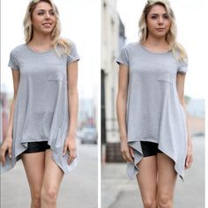 Gray High Low Top A must have staple piece for your closet! Very versatile piece.  Material is 94% rayon and 6% spandex.  Approximate measurements: small bust 34 inches, waist 40 inches, front length 27 inches, side 33 inches.  Medium bust 36 inches, waist 41 inches, front length 27 inches, side length 34 inches.  Large bust 38 inches, waist 42 inches, front length 28 inches, side length 35 inches. Tops