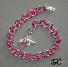 Hard to find words to describe how a simple piece of man made jewelry can symbolize such a level of sentiment, strength, courage, and love. This Breast Cancer Awareness Bracelet features pink jump rings, pink swarovski crystals, and a silver awareness ribbon. Handcrafted by Divine Inspirations Jewelry  Check out my Etsy shop: https://divineinspir8ions.etsy.com Or my facebook: www.facebook.com/pages/divine-inspirations-jewelry/119517998156621