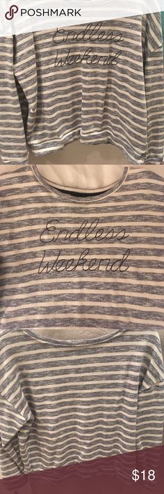 "Endless Weekend Nautical Summer Sweater BNWOT Adorable grayish navy and cream nautical striped long sleeved oversized and slouchy summer sweater with an ""Endless Weekend"" script printed on the front, terry cloth like fabric, perfect for cooler nights on the beach, by a bonfire, or at the lake with jeans or shorts and either slid to one bare shoulder or with a flirty Lace bralette strap showing! Excellent condition, only worn once, size XL, cut size tag off because it was scratchy Tops Tees…"