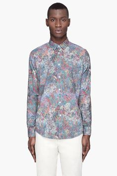 Maison Martin Margiela Blue Pointillist Printed Button Down -  Maison Martin Margiela Blue Pointillist Printed Button Down Maison Martin Margiela Long sleeve dress shirt. Multicolor point pattern printed throughout. Spread collar. Button closure at front. Single_button barrel cuffs with buttoned sleeve placket. Tonal stitching. Price $515.00 Click HERE for...