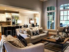 Beautiful, comfy living room open to the kitchen & dinning room.