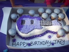 My daughter's Rockstar birthday. Guitar cake and microphone cupcakes!