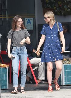 Coffee time:Lily Collins caught up with a friend in Los Angeles, California, on Tuesday...