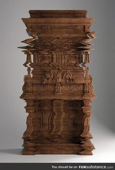 """This cabinet called """"Good Vibrations"""" was intricately carved to look like it's vibrating"""
