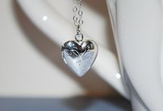Sweet heart locket. Small silver locket, locket with sterling silver chain, child's locket, gift on Etsy, $24.00