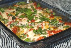 Italian Chicken - 1 can artichoke hearts, 5 bone/skinless chicken breasts,7 tomatoes,1.5c mozz cheese,basil,2.5tbsp olive oil,3 garlic cloves,2tbsp flour - mix artichoke, tomato, garlic,olive oil & flour together. Place chicken in baking dish, cover with tomato mixture. Bake @ 370*F until chicken is cooked. Sprinkle mozzarella cheese and place under broiler until cheese is melted. Top with chopped basil.