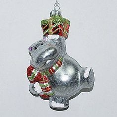 The hippo appears to be wrapped in a festive holiday bow, although the entire ornament is made of fine glass. Description from kmart.com. I searched for this on bing.com/images