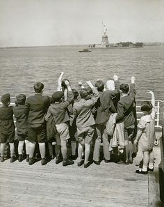 Jewish refugee children waving at the Statue of Liberty from the deck of the liner President Harding in 1939. Of 270,000 German Jews who applied for immigration visas, only 80,000 were allowed into the United States.