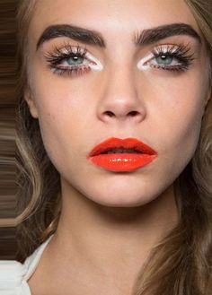 Red-orange lips + white eyeshadow/eyeliner...LOVE!