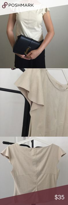 Max studio khaki top 100% polyester. Looks like suede. Light tan color. Soft and comfy fabrics. Ruffle sleeves. Very nice cutting. Slim fit. Max Studio Tops Tees - Short Sleeve