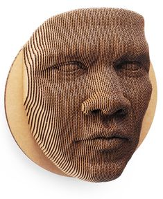 The Jack Cardboard Wall Mask is an 87-piece topographical face mask made from 50% recycled cardboard.