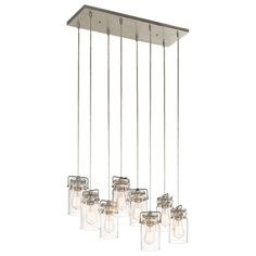 """This 8-light linear chandelier from the Brinley collection features a brushed nickel finish that will complement many lodge, loft, country, or rustic decors. The """"canning jar"""" glass shades add interes"""
