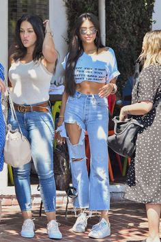 Madison Beer wearing Adidas Stan Smith Sneakers and Re/done High Rise Crop Flare Jeans
