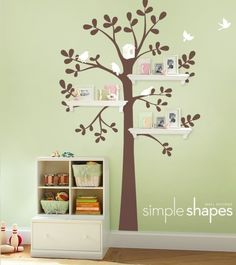 Like this idea for family tree in living room. Can't decide if it's too nursery-ish.