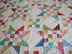 Lizzie the quilter: My scrap jar quilt, no tutorial but looks easy enough to recreate.  Plus I love the blogger name.  It makes me think that one day I might be referring to my lizzy as lizzy the quilter :)