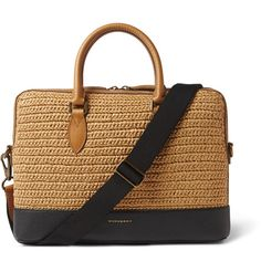 Combining two rich textures, this Burberry briefcase is a tactile take on a considered design. One section is made from camel raffia hand-woven into thick braids for an artisanal look, while the base is crafted from deeply grained black leather. This piece is finished with a gold designer emblem, for an added touch of luxury. Use it to keep all your key essentials in check when out and about town.