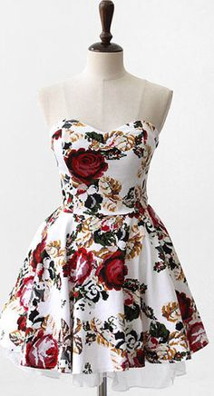 Strapless floral dress that I could accessorize any way I want. Would be perfect for a date.